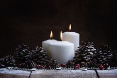 White burning candle with pine cones and cranberries, Christmas Stock Photos