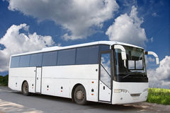 The white bus. The white excursion bus against the blue sky Royalty Free Stock Image
