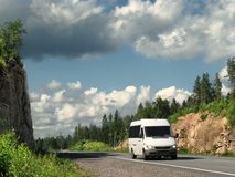 White bus on highway. White bus on summer highway Royalty Free Stock Photos