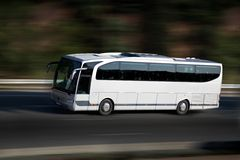 White bus on higway Royalty Free Stock Photos