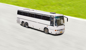 White bus in motion Royalty Free Stock Image