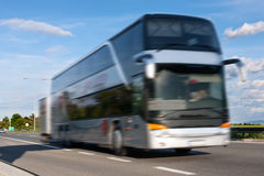 White bus in motion blur on the highway Royalty Free Stock Photos