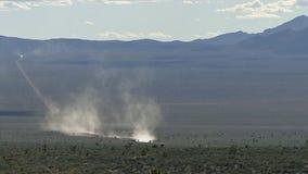 White bus traveling on groom lake road through nevada desert stock footage