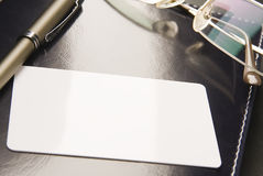 _White business card lays on organizer_ Stock Image