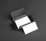 White business cards in the gray box. Royalty Free Stock Image