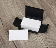 White business cards in the gray box. Stock Images