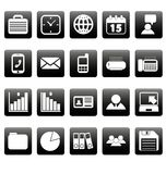 White business icons on black squares Royalty Free Stock Photos