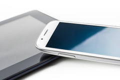 A White Business Smartphone With Reflection Leaning On A Tablet #2 Royalty Free Stock Images