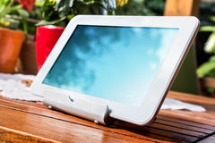 White Business Tablet On A Stand In Relaxing Atmosphere Stock Images