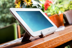 White Business Tablet On Wooden Table In Relaxing Atmosphere Stock Photo