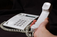 White business telephone on hand Stock Photos