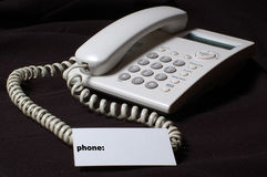 White business telephone on table. Royalty Free Stock Image