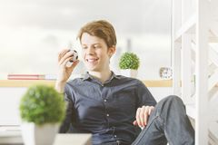 White businessman playing at workplace. Portrait of white businessman playing at modern office workplace. Leisure, break, youth, fun, success concept stock images