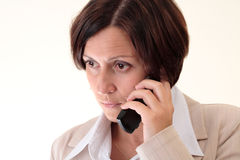 White businesswoman with handy, unhappy Royalty Free Stock Images