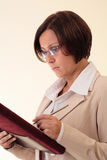 White businesswoman with notepad Stock Photography