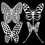 White butterflies on a black background. Set white butterflies on a black background Royalty Free Stock Image