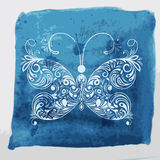 White butterfly on watercolor  background. White butterfly on watercolor blue background with blots and splashes Royalty Free Stock Image