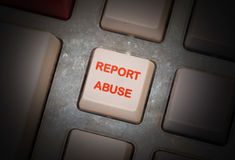White button on a dirty old panel. Selective focus - report abuse Stock Image