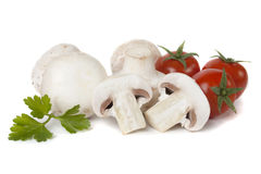 White button mushrooms with cherry tomato Stock Images