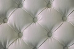 White buttoned leather texture. White leather background with button Royalty Free Stock Image