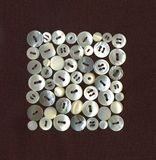 White buttons. Collection of antique buttons of mother of pearl Royalty Free Stock Images