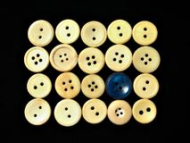 White buttons ornament 1. Assorted buttons on black background Royalty Free Stock Photo