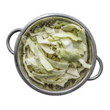 White cabbage fresh washed and cut in a metal colander on a wood Stock Photo