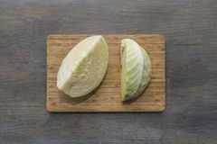 White cabbage fresh washed and cut on wood cutting board on a wo Royalty Free Stock Photography