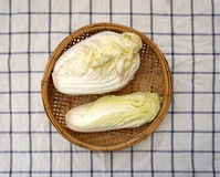 White cabbage on woven basket Royalty Free Stock Images
