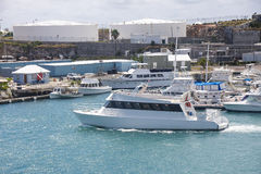 White Cabin Cruiser Leaving Bermuda Harbor Royalty Free Stock Image