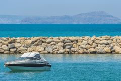 White cabin cruiser over blue water. A luxury private motor yacht under way on Black Sea sea. White cabin cruiser over blue water. A luxury private motor yacht Stock Image