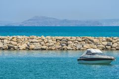 White cabin cruiser over blue water. A luxury private motor yacht under way on Black Sea sea. Stock Image