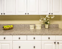 White Cabinets with Granite Countertop Royalty Free Stock Image