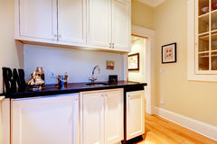 White cabinets of space between kitchen and dindng room - serving room. Royalty Free Stock Photography