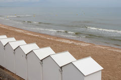 White cabins were placed on a beach (France) Royalty Free Stock Photos