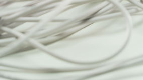 White Cables. Camera Moving From Up to Down. Lots of Cables. Extreme close-up. Shot on RED Epic stock footage