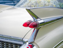 White cadillac. Tail fin up close Royalty Free Stock Photo
