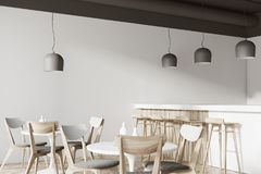 White cafe corner with a bar. Corner of a white cafe with a wooden floor, round white tables and gray and wooden chairs. A bar with stools. 3d rendering mock up Royalty Free Stock Images