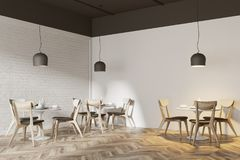 White cafe corner. With a wooden floor, round white tables and gray and wooden chairs. 3d rendering mock up Royalty Free Stock Images