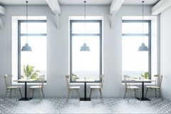 White cafe interior wooden tables Stock Photo