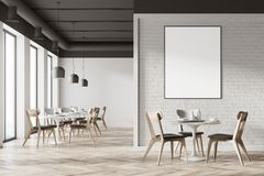 White cafe interior, poster. White cafe interior with a wooden floor, tall windows and gray and wooden chairs near round tables. A poster. 3d rendering mock up Stock Photography