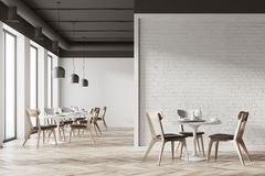 White cafe interior, wall. White cafe interior with a wooden floor, round white tables and gray and wooden chairs. A white wall fragment. 3d rendering mock up Royalty Free Stock Photography