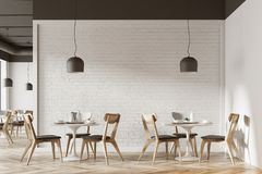 White cafe interior. With a wooden floor, round white tables and gray and wooden chairs. 3d rendering mock up Stock Photo