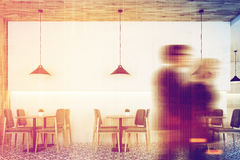 White cafe, wooden ceiling, people Royalty Free Stock Images