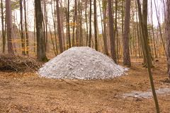 A white cairn in the woods royalty free stock photos