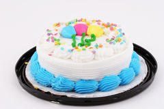 White cake. White frosted cake with frosting balloons Royalty Free Stock Photography