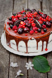 White cake with berries and biscuits Stock Photo