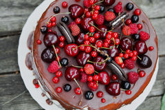 White cake with berries and biscuits Stock Image
