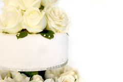 White cake with a bunch of yellow roses. On the top Stock Photography