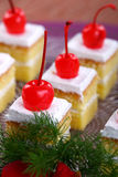 White Cake with cherries. With beautiful background in studio Royalty Free Stock Photo